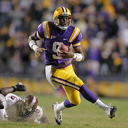 15 November 2008: LSU freshman quarterback Jordan Jefferson (9) runs away from Troy defensive back Sherrod Martin (6) during the first half of the NCAA football game between the Troy Trojans and the LSU Tigers at Tiger Stadium in Baton Rouge, LA.