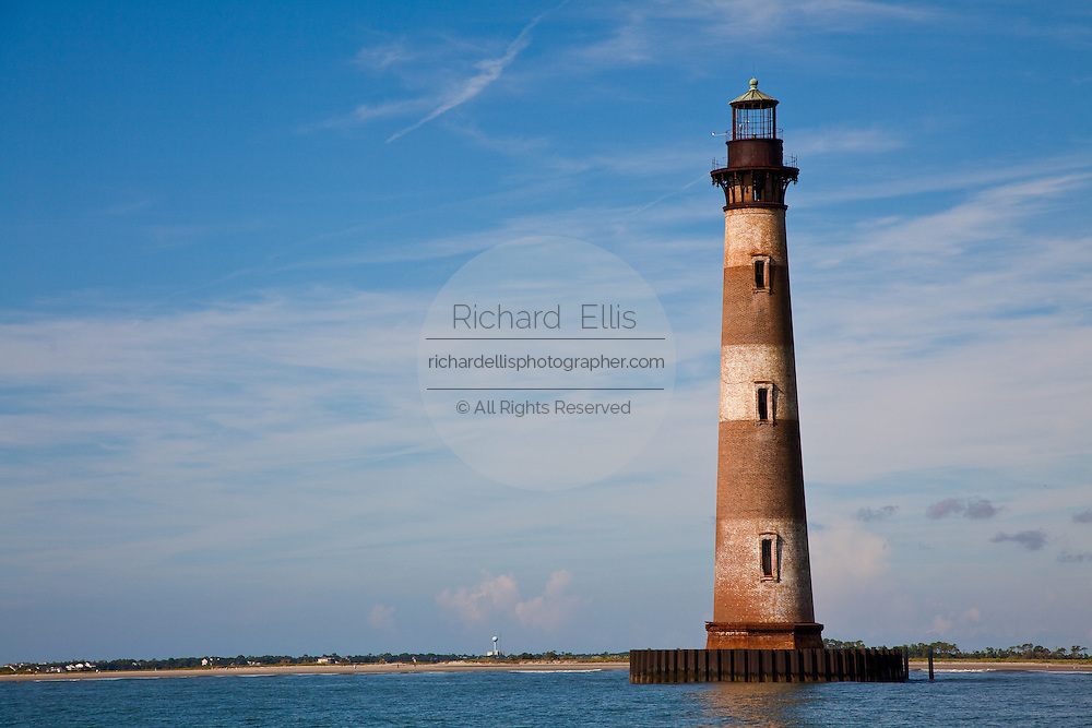 Historic Morris Island lighthouse surrounded by water in Charleston, South Carolina. The lighthouse was originally constructed in 1767