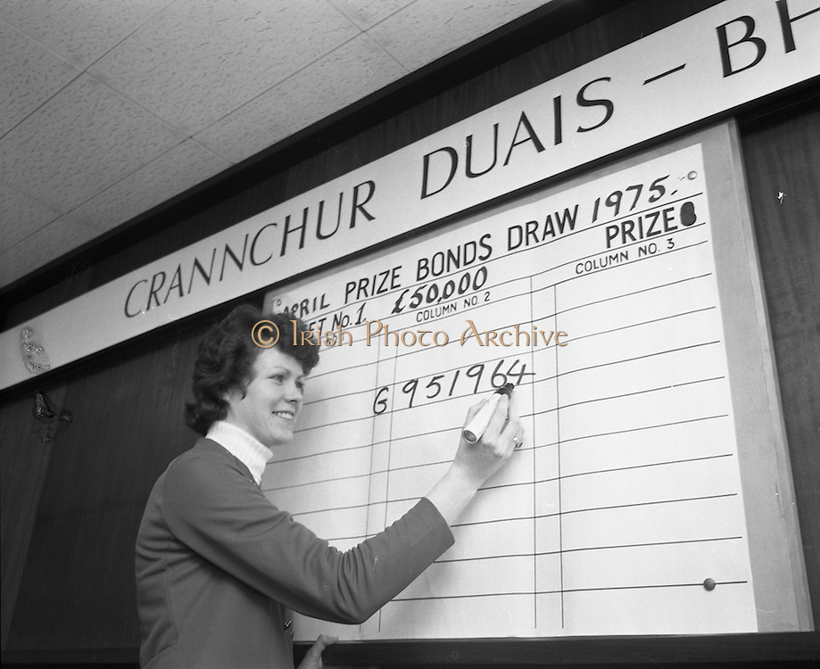 Prize Bonds Draw      (J26).1975..02.04.1975.04.02.1975.2nd April 1975..The first monthly draw held under the terms of the new prospectus of the prize bonds was held at the prize bond office, Bank of Ireland, 33-41 Lower Mount Street, Dublin..In this draw and future draws a new prize of £50,000 will will be drawn each month.
