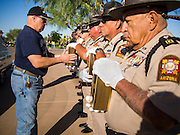08 OCTOBER 2013 - PHOENIX, AZ:  Members of Veterans Of Foreign Wars honor guard unit hold urns containing the cremated remains of a US military veteran. The cremated remains of 36 unclaimed US military veterans were interred at the National Memorial Cemetery in Phoenix. Members of the US military and several hundred veterans of the US military attended the service, which was a part of the Missing In America Project (MIAP).   PHOTO BY JACK KURTZ