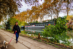 A woman walks her dog along the tow path of the Canal du Midi, Toulouse, France<br /> <br /> (c) Andrew Wilson | Edinburgh Elite media