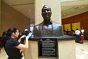 Singapore. Fullerton Hotel. The atrium lobby. Bust of Ng Teng-Fong.