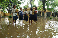 EKANGERSERAI, BIHAR: AUGUST 11:Indian children leave Middle School Ekangerserai school after monsoon rains flood their classrooms in a village about 100 kilometers from Patna in the state of Bihar, India August 11, 2003.  Bihar is the poorest state in India and girls often suffer the most because of the poverty, lack of education and opportunities. (Photo by Ami Vitale)