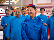 """09 FEBRUARY 2014 - HAT YAI, SONGKHLA, THAILAND: Men at a 108 Hainanese Ancestors Memorial Day in Ruby Goddess Shrine in Hat Yai, Songkhla, Thailand. Hainanese communities around the world celebrate """"108 Hainanese Ancestors Memorial Day."""" The day honors the time when 109 Hainanese villagers fleeing life in Hainan (an island off of the southwest coast of China, near Vietnam) washed up in what is now Vietnam and were killed by Vietnamese authorities because authorities thought they were pirates. The Vietnamese built a temple on the site and named it """"Zhao Yin Ying Lie."""" Many Vietnamese fisherman credit prayers at the temple to saving their lives during violent storms and now """"108 Hainanese Ancestors Memorial Day"""" is celebrated in Hainanese communities around the world. Hat Yai, the economic center of southern Thailand has a large Hainanese population.    PHOTO BY JACK KURTZ"""