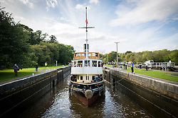 "© Licensed to London News Pictures. 30/09/2016. Bartington UK. Picture shows the Daniel Adamson making it's way through Dutton locks on the River Weaver on it's maiden voyage after a £5M renovation. The Daniel Adamson steam boat has been bought back to operational service after a £5M restoration. The coal fired steam tug is the last surviving steam powered tug built on the Mersey and is believed to be the oldest operational Mersey built ship in the world. The ""Danny"" (originally named the Ralph Brocklebank) was built at Camel Laird ship yard in Birkenhead & launched in 1903. She worked the canal's & carried passengers across the Mersey & during WW1 had a stint working for the Royal Navy in Liverpool. The ""Danny"" was refitted in the 30's in an art deco style. Withdrawn from service in 1984 by 2014 she was due for scrapping until Mersey tug skipper Dan Cross bought her for £1 and the campaign to save her was underway. Photo credit: Andrew McCaren/LNP"
