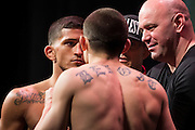 DALLAS, TX - MARCH 13:  Sergio Pettis faces off with Ryan Benoit during the UFC 185 weigh-ins at the Kay Bailey Hutchison Convention Center on March 13, 2015 in Dallas, Texas. (Photo by Cooper Neill/Zuffa LLC/Zuffa LLC via Getty Images) *** Local Caption *** Sergio Pettis; Ryan Benoit