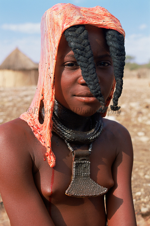 Himba girl with cow peritoneum on head for rite of passage to adulthood. Kaokoland, Namibia