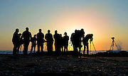 A group of photographers at sunset