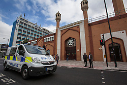 © licensed to London News Pictures. London, UK 10/06/2013. Police van patrolling outside The East London Mosque on Monday, 10 July 2013. Photo credit: Tolga Akmen/LNP