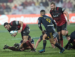 Crusaders Bryn Hall , left, takes the ball into the tackle against the Highlanders in the Super Rugby quarter final match, AMI Stadium, Christchurch, New Zealand, July 22 2017.  Credit:SNPA / Adam Binns ** NO ARCHIVING
