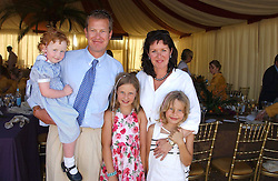 LORD & LADY IVAR MOUNTBATTEN and their childre, left to right, LULI, ELLA and ALIX at the Veuve Clicquot sponsored Gold Cup Final or the British Open Polo Championship held at Cowdray Park, West Sussex on 17th July 2005.<br /><br />NON EXCLUSIVE - WORLD RIGHTS