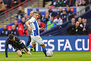 Brighton & Hove Albion midfielder Anthony Knockaert (11) evades a sliding tackle by Manchester City midfielder David Silva (21) during the The FA Cup semi-final match between Manchester City and Brighton and Hove Albion at Wembley Stadium, London, England on 6 April 2019.