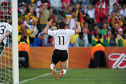Miroslav Klose celebrates after scoring the opening goal for Germany during the 2010 World Cup Soccer match between England and Germany in a group 16 match played at the Freestate Stadium in Bloemfontein South Africa on 27 June 2010.