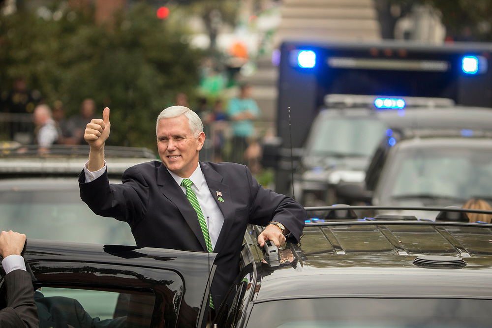 Vice President Mike Pence give a crowd a thumbs-up right before climbing into his motorcade at the Savannah St. Patrick's Day parade, Saturday, March 17, 2018, in Savannah, Ga. Irish immigrants to Savannah and their descendants have been celebrating St. Patrick's Day with a parade since 1824. (AP Photo/Stephen B. Morton)