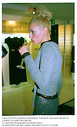 Laura de Palma drinking champagne. Valentino shop party.Sloane St. London. 21/10/96. Film 96634f5<br />