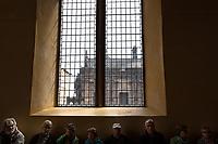 Group of older men and women take a break at Edinburgh Castle, in Edinburgh, Scotland. Copyright 2019 Reid McNally.