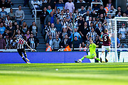 Newcastle United midfielder Christian Atsu (#30) crosses the ball leaving West Ham United goalkeeper Joe Hart (#25) stranded while Newcastle United forward Joselu (#21) taps the ball into the net during the Premier League match between Newcastle United and West Ham United at St. James's Park, Newcastle, England on 26 August 2017. Photo by Craig Doyle.