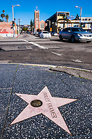 United States, California, Los Angeles. Hollywood Boulevard with the Walk of Fame and the Hollywood sign in the background.