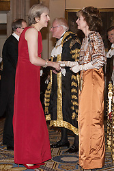 © Licensed to London News Pictures. 14/12/2016. (L to R) British Prime Minister Theresa May and Lady Mayoress Wendy Parmley attend the annual Lord Mayor's Banquet at Guildhall. London, UK. Photo credit: Ray Tang/LNP