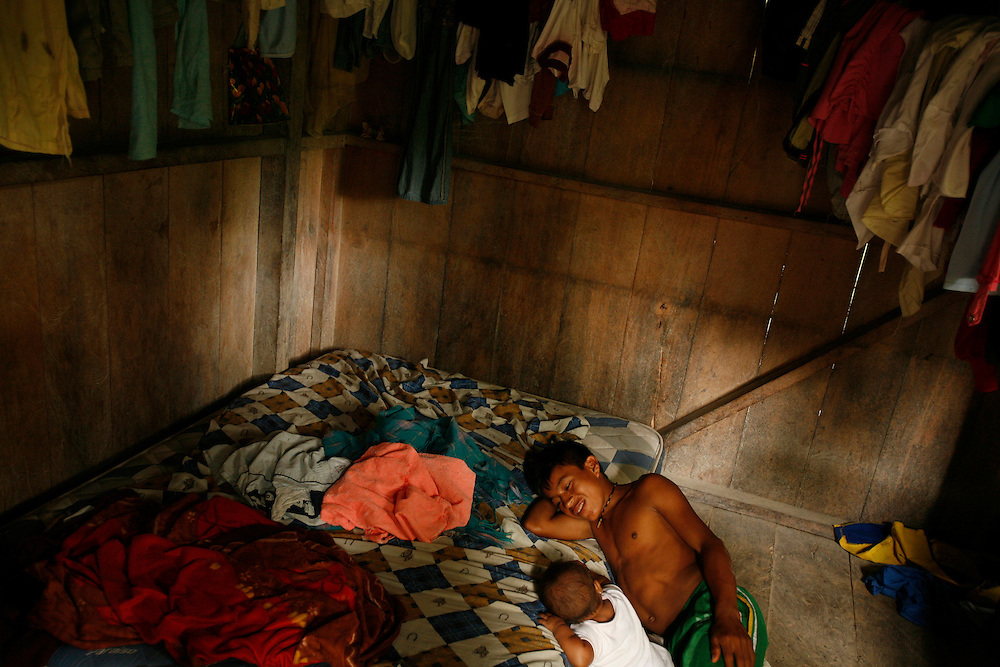 A boy and his niece hang out in a room near San Pedro Sumino in August of 2009.  Usually older kids take care of the younger ones. Many of the houses have family and extended family living in it.