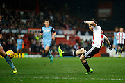 Brentford Sergi Canos (47) has a shot on goal during the EFL Sky Bet Championship match between Brentford and Rotherham United at Griffin Park, London, England on 25 February 2017. Photo by Andy Walter.