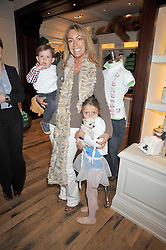 GRANIA STEPHENSON and her children CLRYS and THEODORE at 'Paint Your Polo Celebration' a children's party in aid of the charity Clic Sargent held at Ralph Lauren, 139/141 Fulham Road, London on 28th April 2009.
