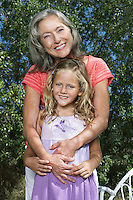 Portrait of grandmother and granddaughter (5-6) in garden