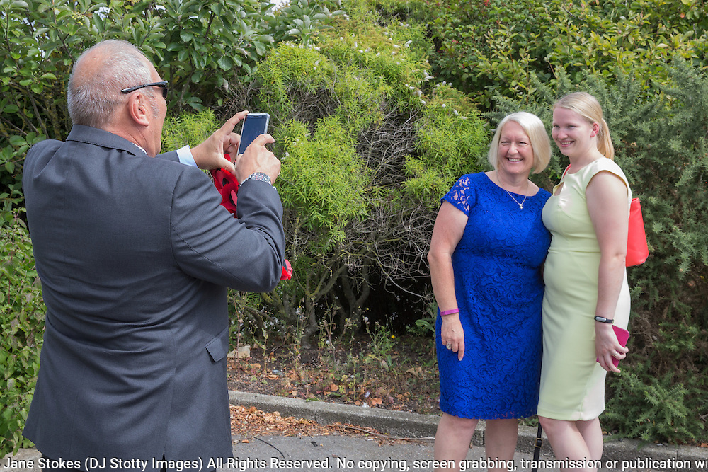 Peter Peace taking a photograph of Jane Pearce and Kirsty Townsend<br /> <br /> 74th Anniversary of the Dieppe Raid (19 August 1942) Memorial Service held at Newhaven Fort and the Canadian War Memorial. Attended by Veterans, dignitaries and guests. Organised by Canadian Veterans Association (Brighton Branch) and Newhaven Council.
