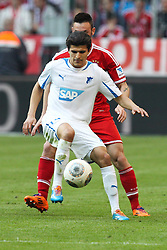 29.03.2014, Allianz Arena, Muenchen, GER, 1. FBL, FC Bayern Muenchen vs TSG 1899 Hoffenheim, 28. Runde, im Bild l-r: im Zweikampf, Aktion, mit Tarik Elyounoussi #14 (TSG 1899 Hoffenheim) und Diego Contento #26 (FC Bayern Muenchen) // during the German Bundesliga 28th round match between FC Bayern Munich and TSG 1899 Hoffenheim at the Allianz Arena in Muenchen, Germany on 2014/03/29. EXPA Pictures © 2014, PhotoCredit: EXPA/ Eibner-Pressefoto/ Kolbert<br /> <br /> *****ATTENTION - OUT of GER*****