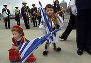 PT 119616 - - DELIVER TO:  - - 3/16/2001 - - New Port Richey - - CAPTION INFO: With flags in hand, Audrey Maria Seraskeris (cq), 3, left, takes a break as Tasos Russell Pappas (cq),  2, tugs at the hat he was dressed in for the occasion outside the Pasco Government Center Friday (03/16/2001) in honor of Greek Independence Day.  Times File Photo by: Brendan Fitterer - - Story By: Stand Alone - - SCANNED BY: BTF - - RUN DATE: