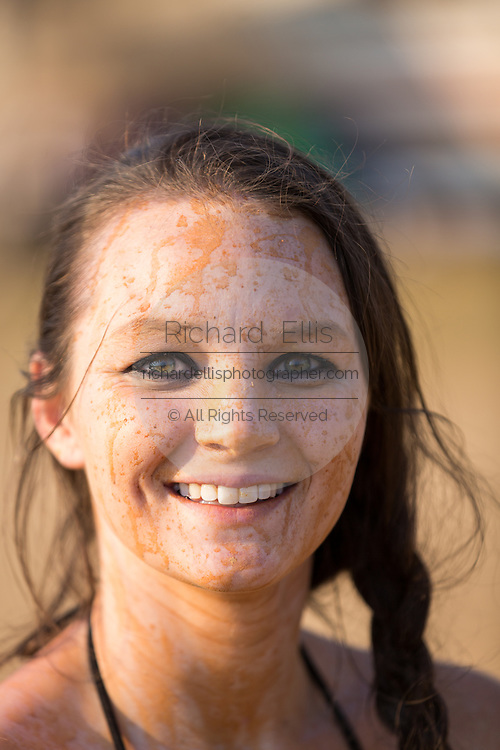 A young woman covered in mud at the 2015 National Red Neck Championships May 2, 2015 in Augusta, Georgia. Hundreds of people joined in a day of country sport and activities.