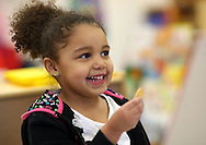 Zaria Larsen, 3, of Cedar Rapids smiles as she eats her afternoon snack at Building Blocks Child Care in Cedar Rapids on Wednesday February 25, 2009.  (Stephen Mally/Freelance)
