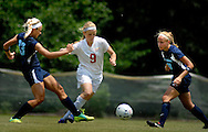 26 MAY 2012 -- TOWN & COUNTRY, Mo. -- Visitation Academy soccer player Abby Grimes (9) splits St. Dominic High School players Alex Schmitz (13) and Molly Ream (10) during the MSHSAA Class 2 girls' soccer quarterfinals at Visitation Saturday, May 26, 2012. St. Dominic topped the Vivettes 8-1 to advance to Friday's semifinals against Helias Catholic High School at Blue Springs South High School. Photo © copyright 2012 Sid Hastings.