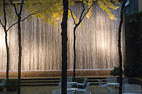Waterfall and empty table and chairs in autumn Midtown Manhattan New York