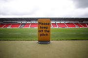 A sign asking people to stay off the pitch before the EFL Sky Bet League 1 match between Doncaster Rovers and Rotherham United at the Keepmoat Stadium, Doncaster, England on 7 September 2019.