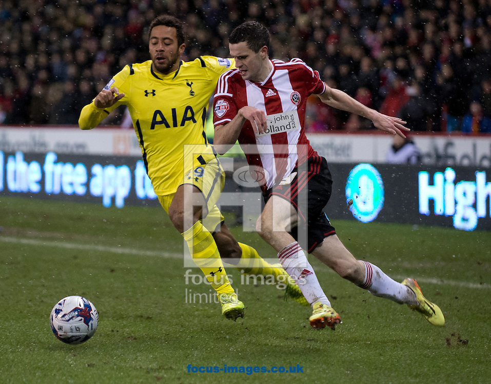 Jamie Murphy of Sheffield United (right) gets past Mousa Dembele of Tottenham Hotspur during the Capital One Cup match at Bramall Lane, Sheffield<br /> Picture by Russell Hart/Focus Images Ltd 07791 688 420<br /> 28/01/2015