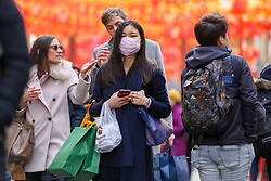 © Licensed to London News Pictures. 01/02/2020. London, UK. An Asian woman is seen in London's Chinatown wearing face masks following the outbreak of Coronavirus in Wuhan, China. <br /> According to the Department of Health, 203 people have been tested in the UK, with 201 results coming back negative and two positive. One of the two people to test positive for is a student at the University of York. Photo credit: Dinendra Haria/LNP