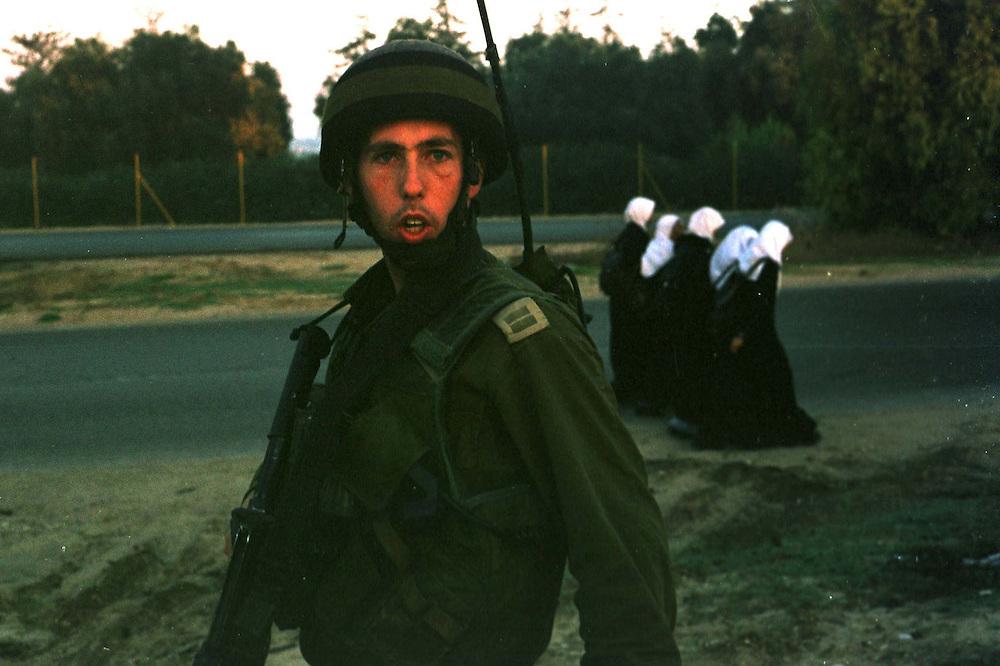 Lt. Avishai Minx on patrol with palestinian women...Photo: Nadav Neuhaus