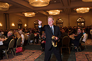 Charlie Jennette points at Hunter Wendelstedt and the other instructors thanking them after he received a golden mask award for his attitude and integrity on the field during the 2016 Student Graduation Banquet Gala.
