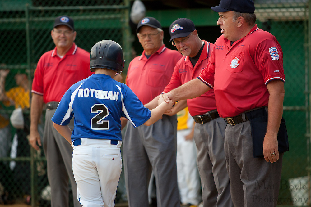 Cherry Hill's Matt Rothman is greeted by the umpires before the Section 4 Little League final held in Gloucester Sunday night.
