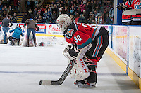 KELOWNA, CANADA - DECEMBER 6: Jordon Cooke #30 of the Kelowna Rockets stands at the bench as volunteers clear the ice after the first annual teddy bear toss against the Everett Silvertips on December 6, 2013 at Prospera Place in Kelowna, British Columbia, Canada.   (Photo by Marissa Baecker/Shoot the Breeze)  ***  Local Caption  ***