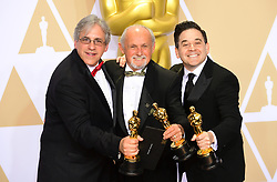 Mark Weingarten, Gregg Landaker and Gary A. Rizzo with their Oscar for Best Sound Mixing for Dunkirk in the press room at the 90th Academy Awards held at the Dolby Theatre in Hollywood, Los Angeles, USA.