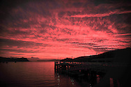 A natural and extremely red sunset seen from the island of Waiheke near the New Zealand capital of Auckland.