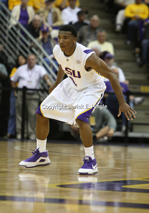 14 February 2009: LSU guard Chris Bass (4) on defense during a NCAA basketball game between SEC rivals the Ole Miss Rebels and the LSU Tigers at the Pete Maravich Assembly Center in Baton Rouge, LA.