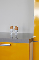 Eggs in eggcups on kitchen counter