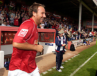 Photo: Daniel Hambury.<br />Walsall v Swindon. Coca Cola League 1.<br />03/09/2005.<br />Walsall's player manager Paul Merson runs out for his first home appearence of the season.