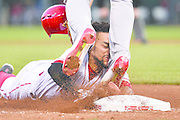 CINCINNATI, OH - JUNE 8:  Billy Hamilton #6 of the Cincinnati Reds slides into the legs of Jhonny Peralta #27 of the St. Louis Cardinals while trying to steal third base in the fifth inning at Great American Ball Park on June 8, 2016 in Cincinnati, Ohio. Hamilton was called out as St. Louis defeated Cincinnati 12-7.  (Photo by Jamie Sabau/Getty Images)