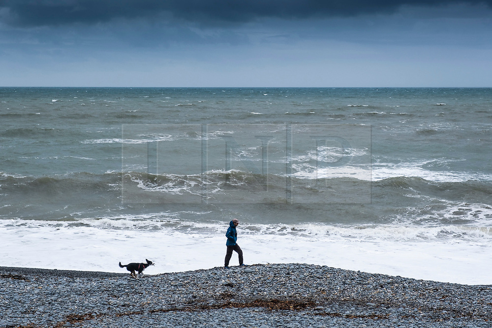 ©Licensed to London News Pictures. 26/04/2019. Aberystwyth, UK. Dark clouds and choppy seas foretell the arrival of Storm Hannah, the latest named storm of the 2019 season. With winds expecting to gust at between 60 and 70mpg overnight, there is a risk of damage to property and injuries. The Met Office has issued a yellow warning for strong winds covering much of the south of the UK from this evening until mid afternoon tomorrow. Photo credit: Keith Morris/LNP