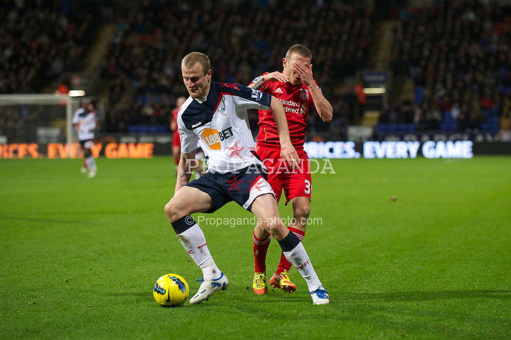 BOLTON, ENGLAND - Saturday, January 21, 2011: Liverpool's Craig Bellamy in action against Bolton Wanderers' David Wheater during the Premiership match at the Reebok Stadium. (Pic by David Rawcliffe/Propaganda)