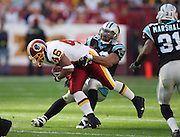 LANDOVER, MD - NOVEMBER 26:  Defensive end Julius Peppers #90 of the Carolina Panthers tackles running back Ladell Betts #46 of the Washington Redskins at FedExField on November 26, 2006 in Landover, Maryland. The Redskins defeated the Panthers 17-13. ©Paul Anthony Spinelli *** Local Caption *** Julius Peppers;Ladell Betts